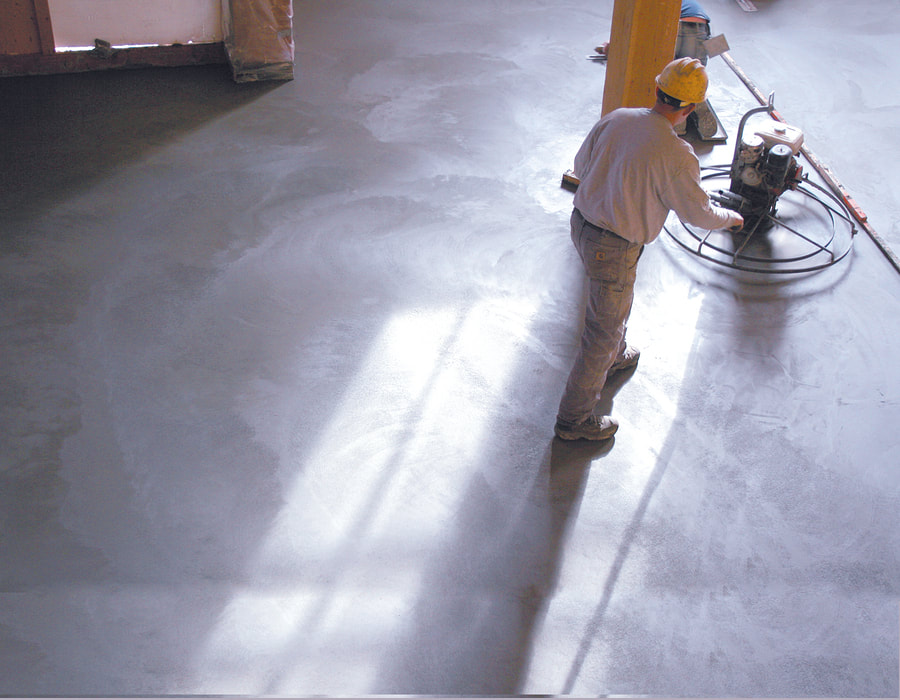 man finishing the floor