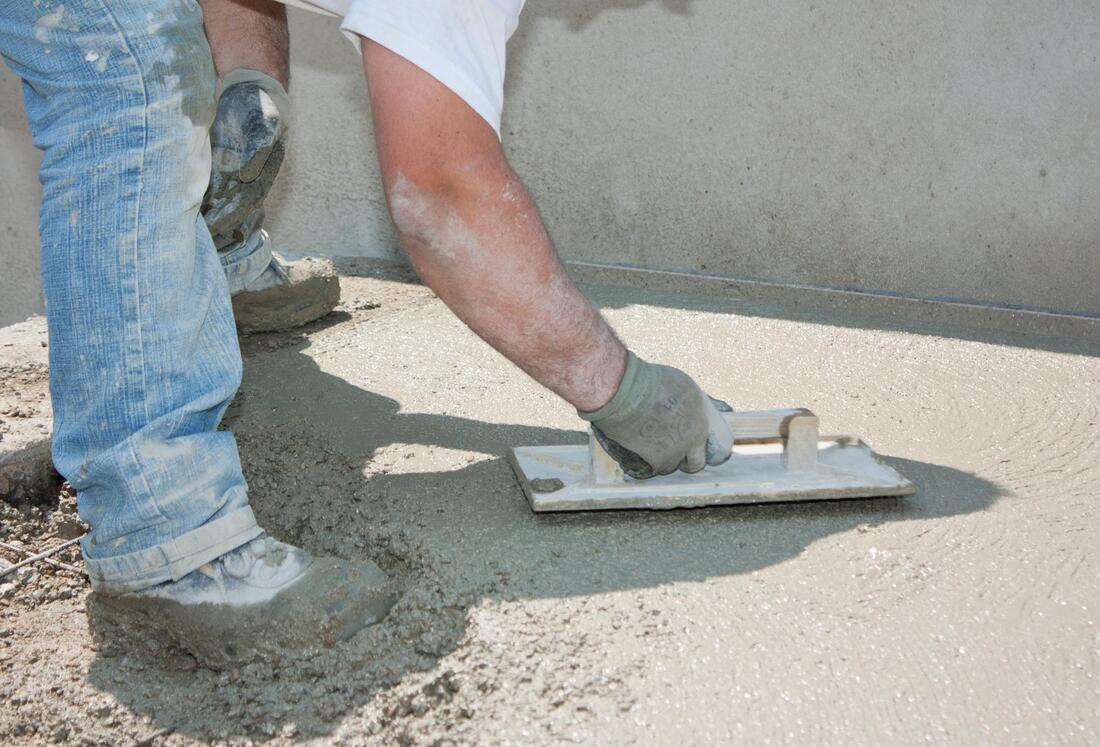 man finishing a floor